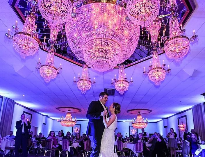 Magical photo of bride and grooms first dance under the chandelier in the Venetian Wedding
