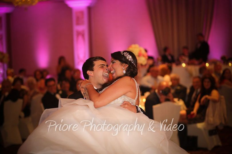 Captured moment of bride and groom on the dance floor in the Amore Ballroom