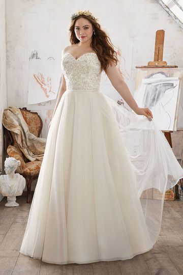 Micaela, Style 3213	Feminine and Dreamy, this Soft Net Ballgown Features a Delicately Beaded and...