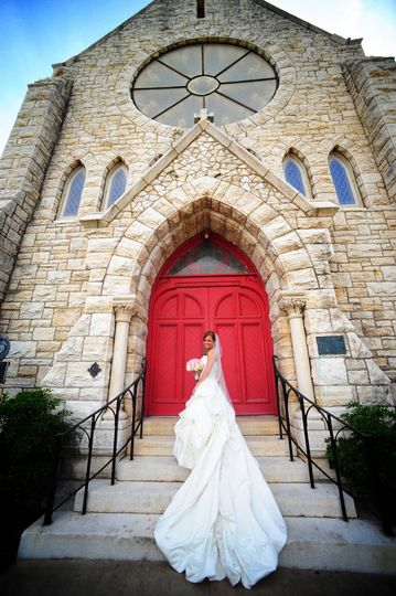 Bride in her dress by the entrance