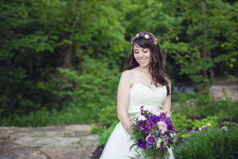 Bride holding purple bouquet