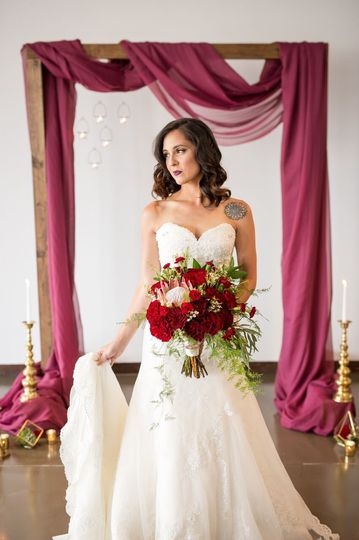 Bride with red bouquet | Aaron Clark Phorography