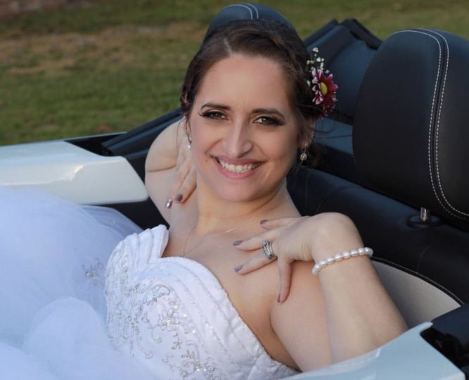 Pamela in her beautiful dress on her way to reception in her convertible car.