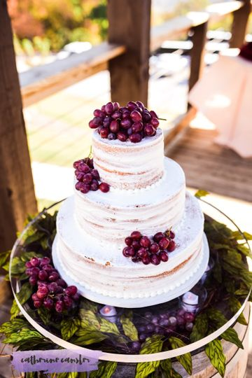 Naked wedding cake covered in berries