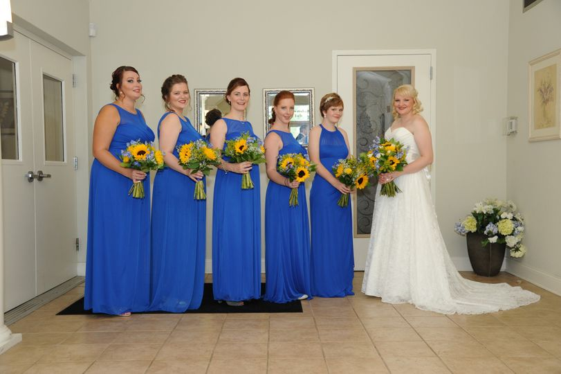 Blue dresses and sunflower bouquets