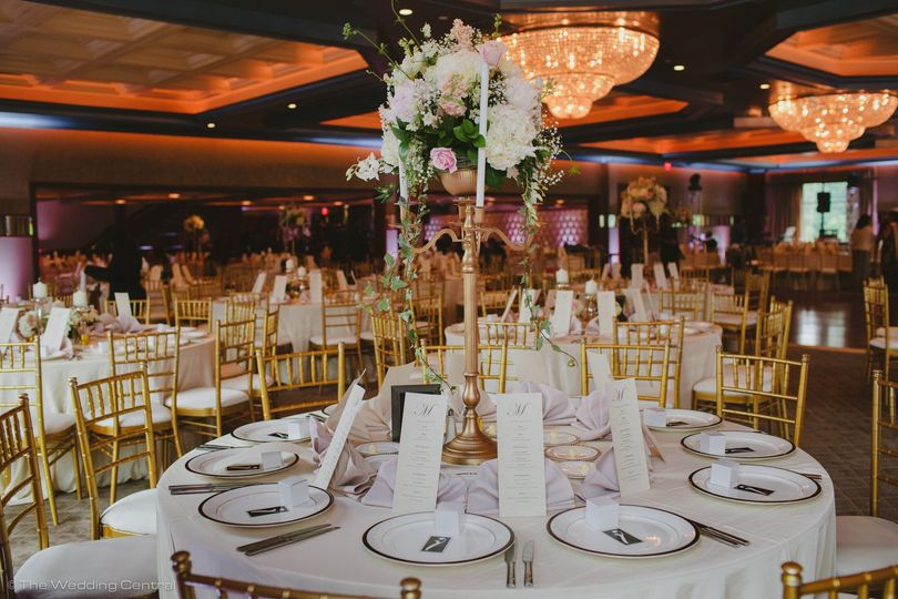 White table setup with centerpiece