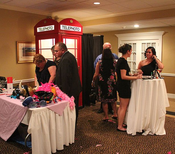 Guests trying the booth