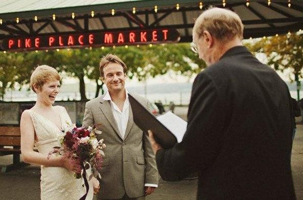 Couple being wed at Pike Place Market