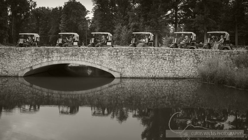 Golf carts on the stone bridge