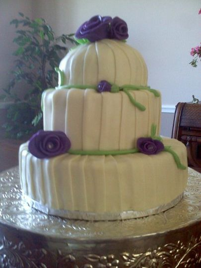 Vanilla Bean cake with Raspberry filing and wrapped in white chocolate.