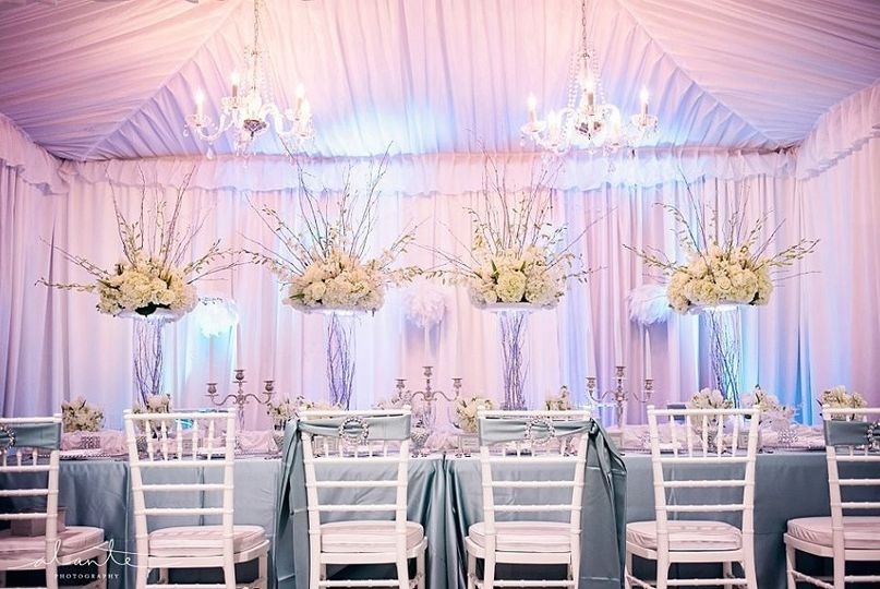 Head table and raised floral centerpieces