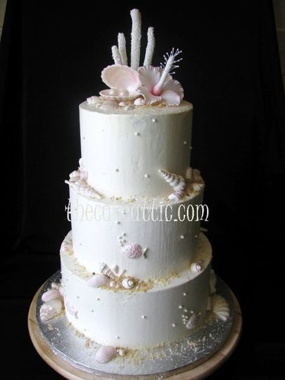 Beach inspired buttercream cake. Chocolate shells and hand-molded sugar flower, coral and pearls.
