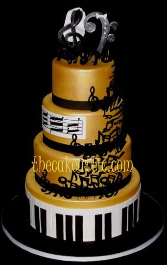 Music themed cake covered in fondant and painted in edible gold luster dust. Piano bottom tier and...