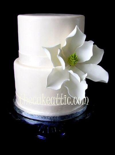 Large sugar Magnolia flower is the only decoration needed on this little cake.
