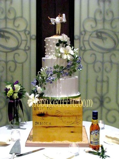 This couple had their destination wedding in the Dominican Republic. Their cake wove the decoration...