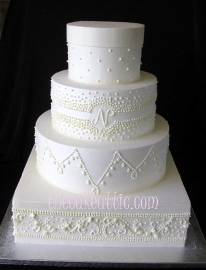 All buttercream cake with piped decorations.