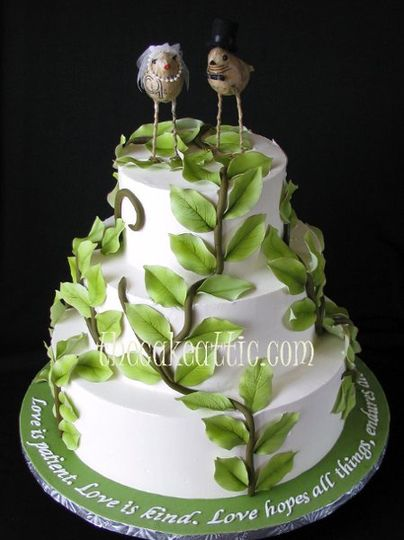 Buttercream cake with outdoor theme.  Sugar vines working their way up the cake. Cake topper...