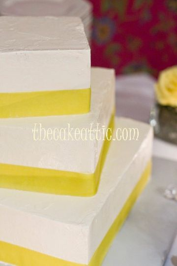 """Square cake with a bit more """"rustic"""" buttercream, tiers have been placed askew. Ribbons purchased by..."""