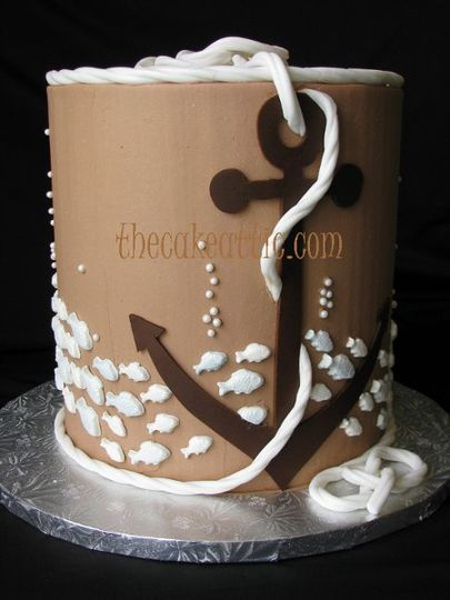 "Double barrel buttercream cake for a ship""s captain. Sugar anchor and chocolate fish."