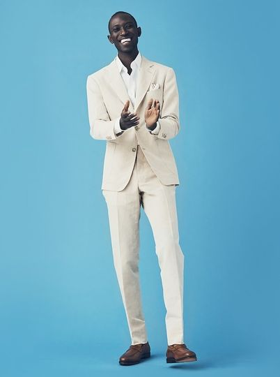 Seaside Celebration: A Tan Suit paired with a crisp White Shirt is the quintessential beach wedding...