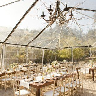 Clear Tent with Chandalier Gives Barn Indoor/Outdoor Feel