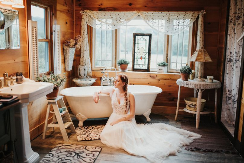 Bride sitting by the tub