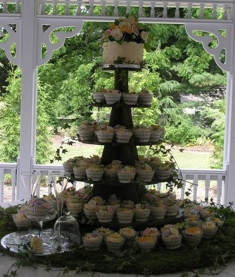 """Cupcake tower with 6"""" cake.  Buttercream icing with handmade gumpaste floral cake topper.   Cupcakes..."""