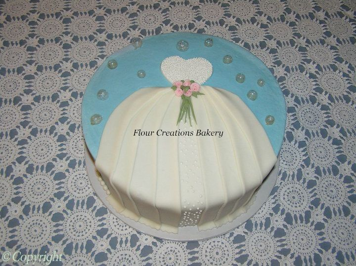 Briesmaid shower cake with buttercream icing and fondnat dress decoration.  All edible.
