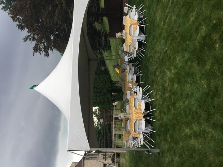 Tent, tables, chairs and linens