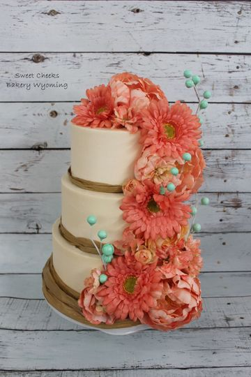 Buttercream with silk florals and gum paste berry sprays