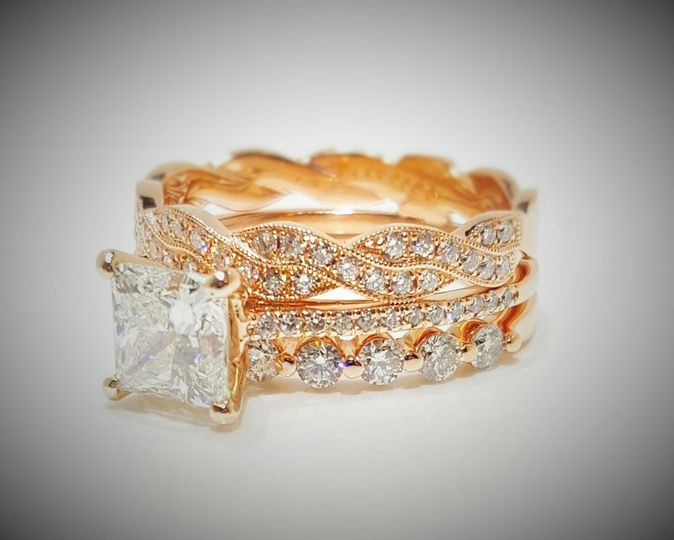 Custom Creation: Princess Cut diamond Center set in 14k Rose Gold solitaire with diamonds on the...