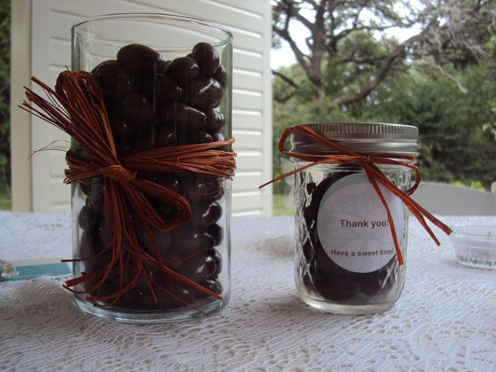 Let your guests fill their mini mason jars with delectable chocolate covered almonds for a sweet...