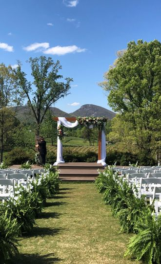 mtn view in april arch w florals draping 51 564606 162017615615885