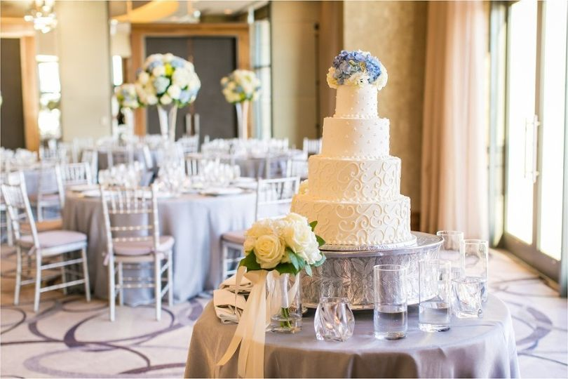 4-tier wedding cake and floral decor