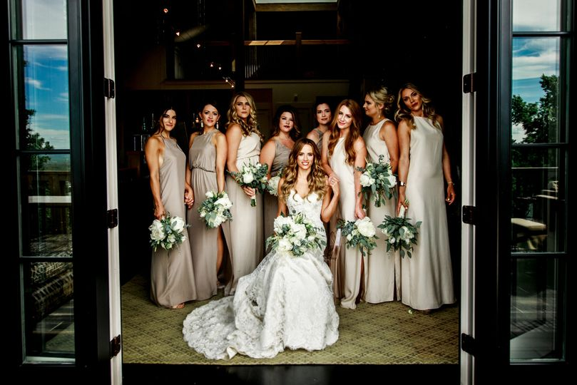 Bride and bridesmaids by the entrance
