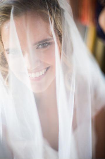 Veiled smile - Bradley Images, inc.