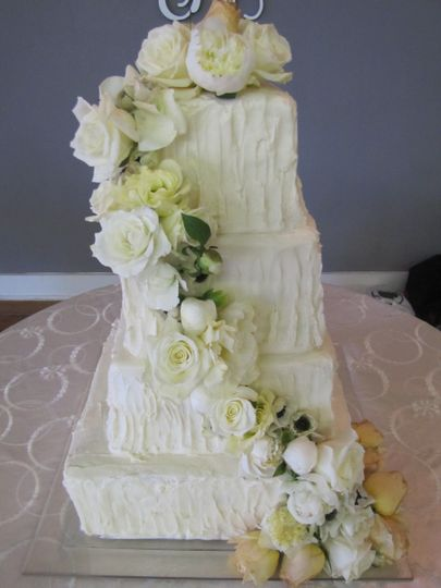 White cake with white floral decorations