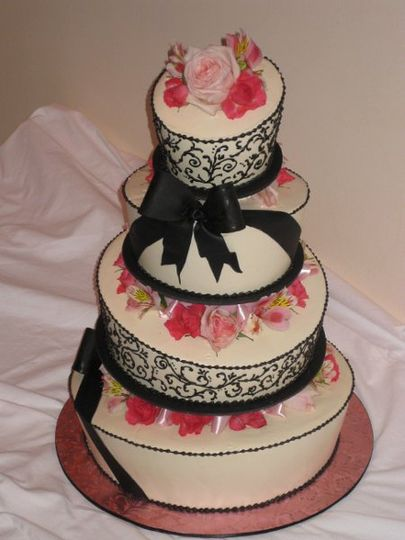 Buttercream Frosting With Fresh Flowers and Black Sugar Bows