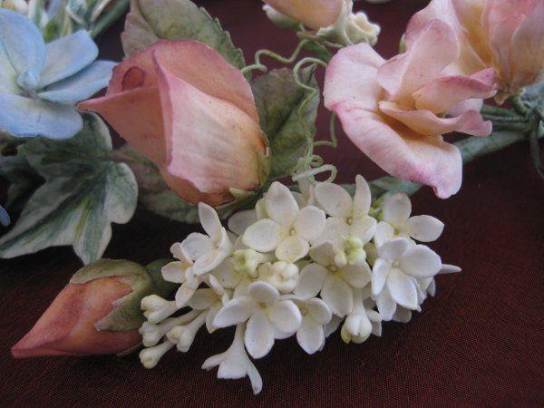 Closeup of Hand-made Sugar Roses, Lilacs, and Hydrangea