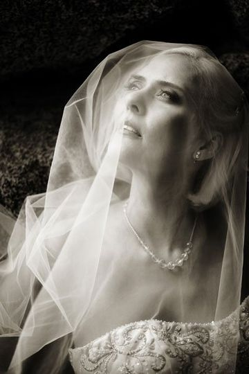 The bride's cathedral length veil was gorgeous during her portraits at The Ahwahnee Hotel following...