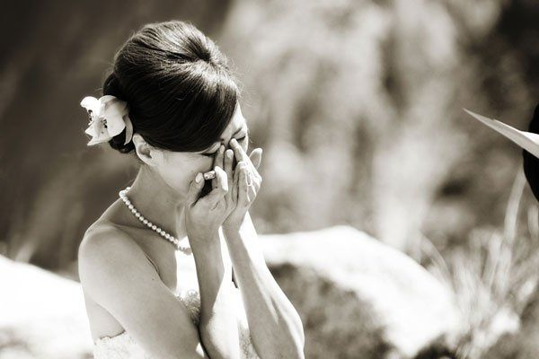 The bride's reaction during her vows at Glacier Point in Yosemite, where the Groom serenaded her...