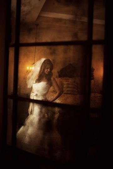 This image was shot as a reflection in the bride's antique mirror.