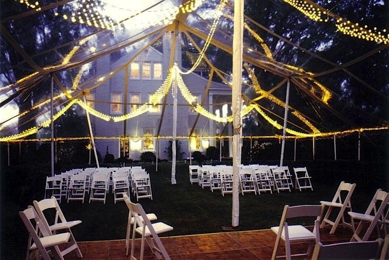 A night wedding we did a very long time ago, with jewel net lighting, white wood chairs, a dance...
