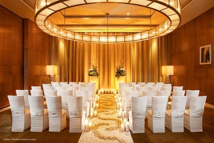 Indoor wedding setup with warm lights