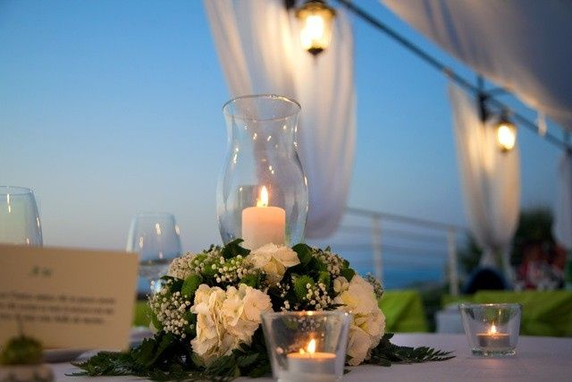 Romantic centerpiece with flowers and candles