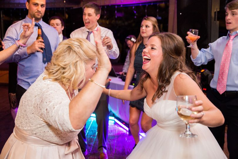 Bride dancing and drinking
