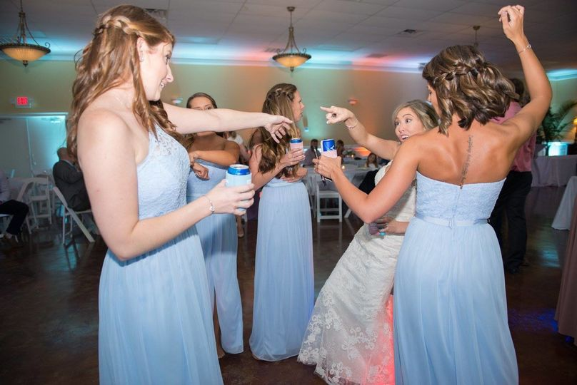 Bride and bridesmaids partying at the dance floor