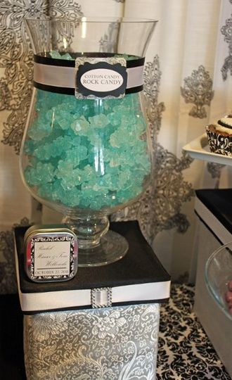 Rock candy adds sparkle and are a guest favorite.  Favor tins were custom-tagged to match the theme.
