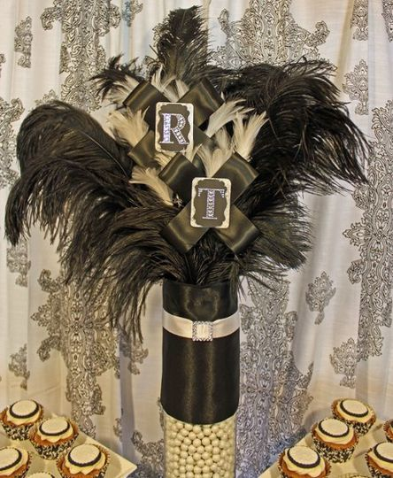 Custom centerpiece created for the buffet with black ostrich feathers, white turkey feathers, and...