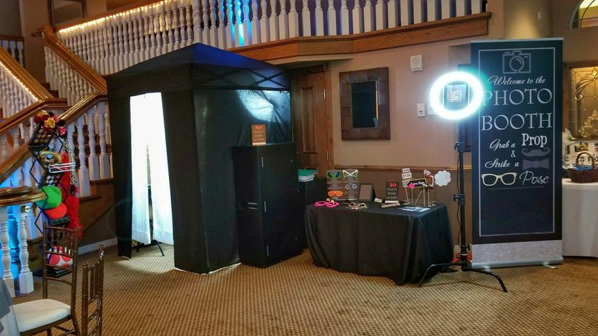 Halo and pop up booth with a props table setup